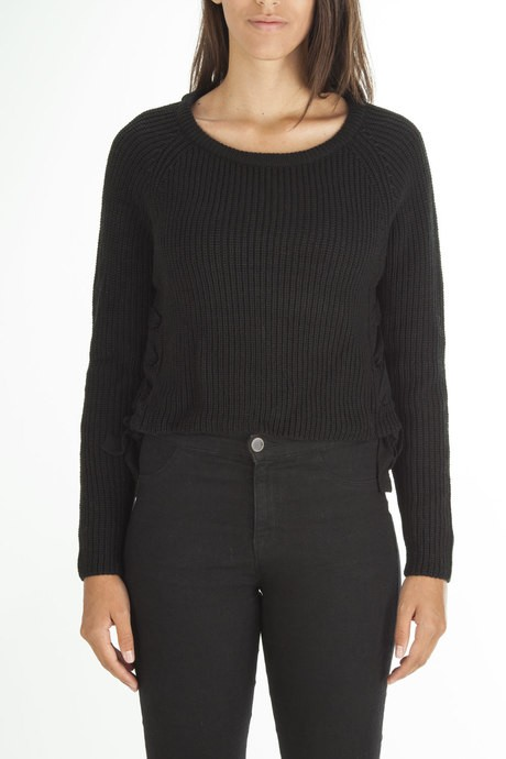 Woman's sweater with twists