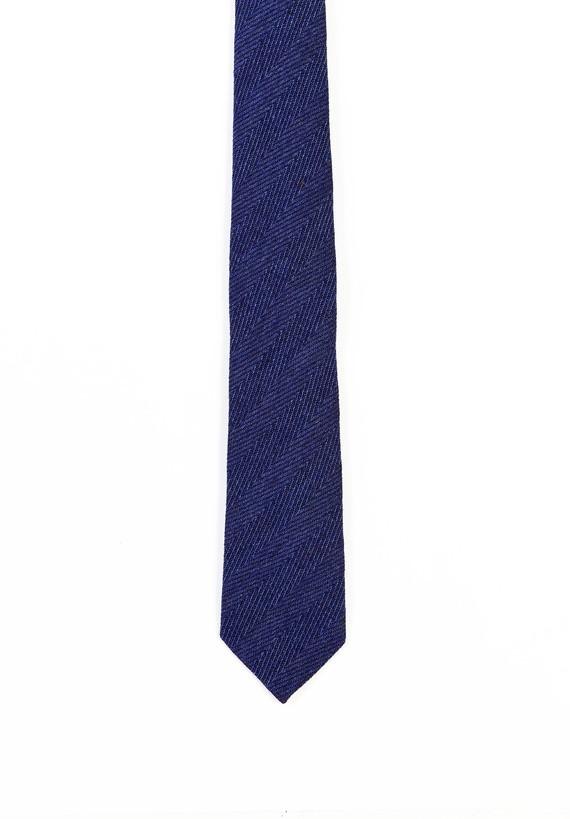 Corbata con efecto espiga