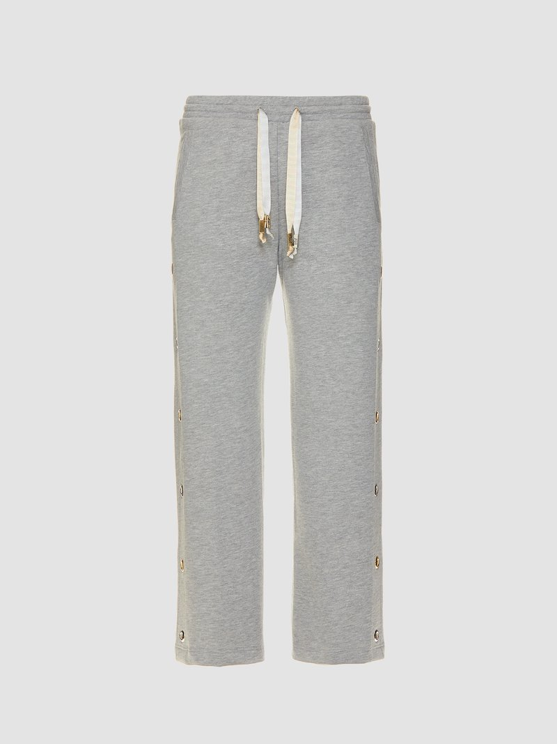 Trousers with eyelets