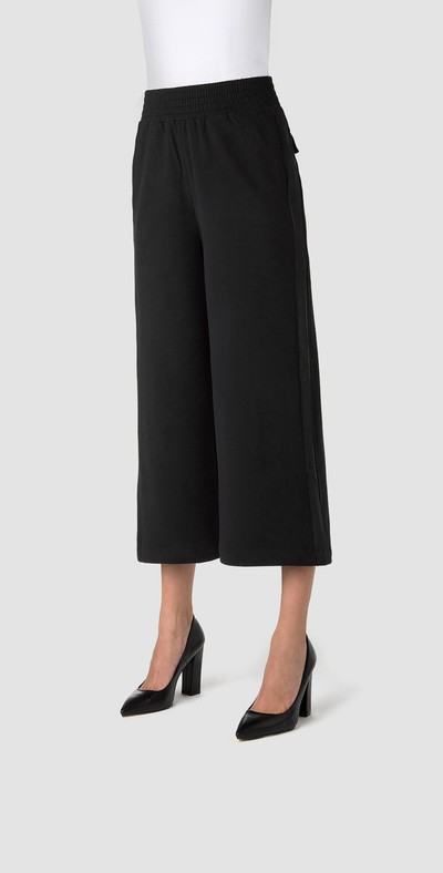 Wide pockets trousers with side band