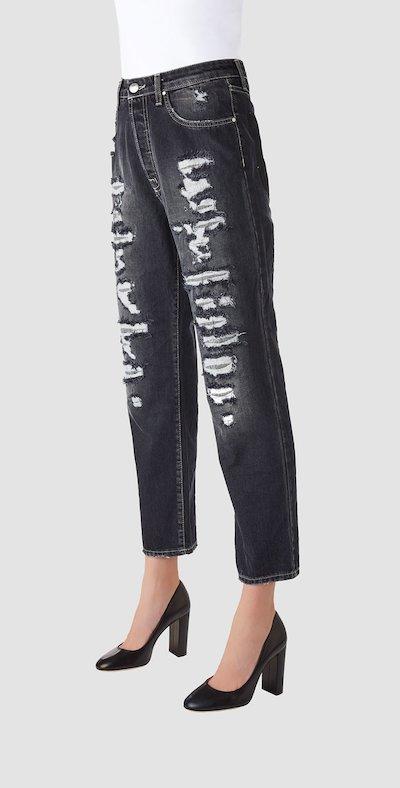 Jeans grigio con strappi