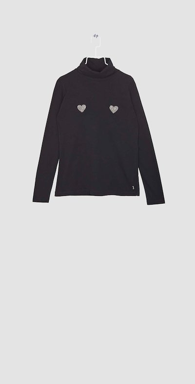 Black turtleneck with glittery heart