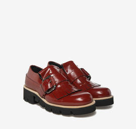 Red leather fringed shoes
