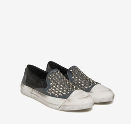 Two-toned studded leather slip-ons