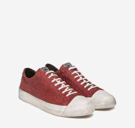 Red carved leather trainers