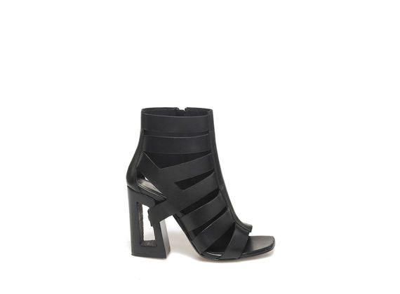 Peep-toe asymmetrical low boot on perforated heel