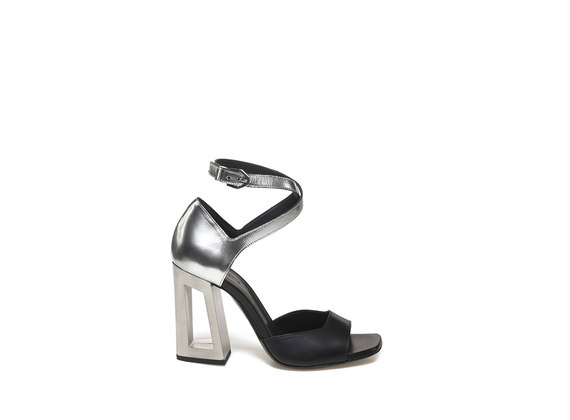 Sandal with metallic, perforated heel