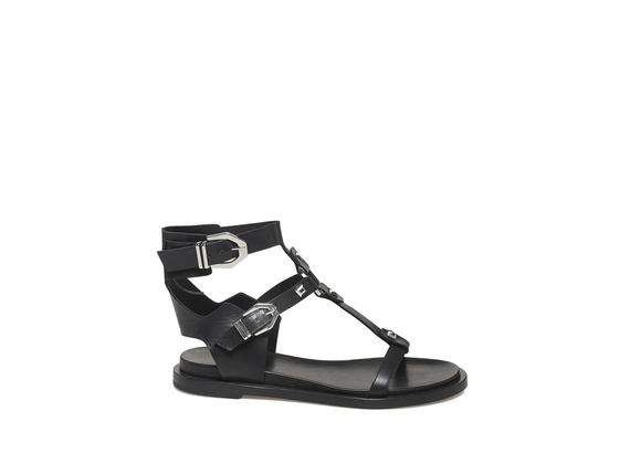 Sandal with studs and buckles