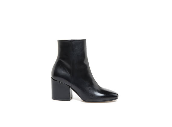 Black leather square-toed ankle boots