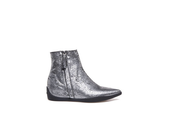 Carved metallic leather ankle boots with rubber bottom