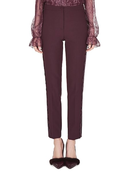 Trousers with band of lace
