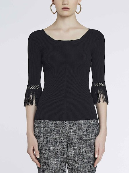 Sweater with openwork and fringe