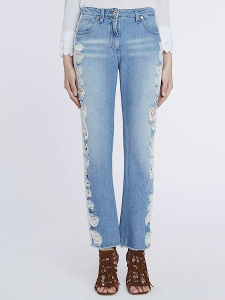 Destroyed jeans with lateral bands in lace