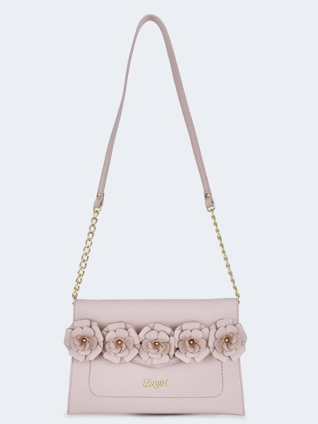 Shoulder bag with appliquéd flowers