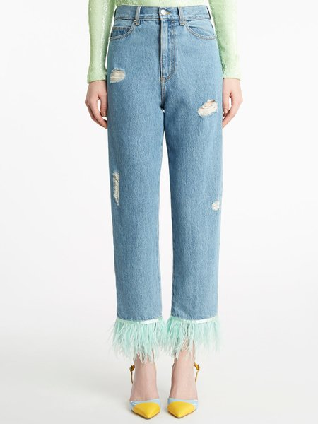 Distressed jeans with ostrich feathers