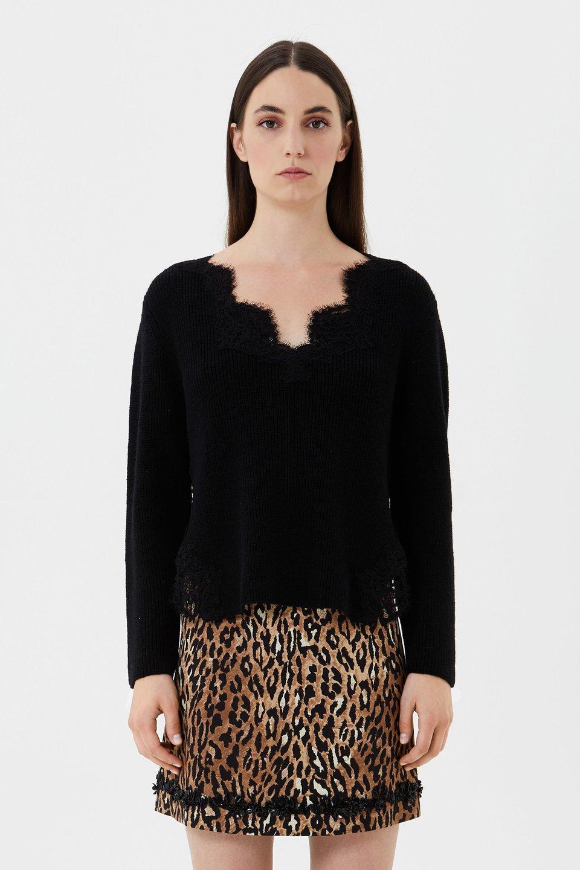 Pullover aus Wolle und Spitze