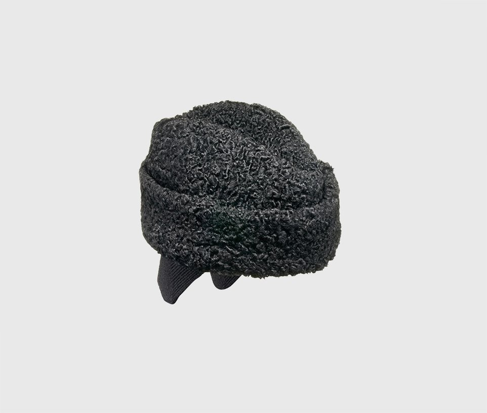 Astrakhan side cap with earmuffs