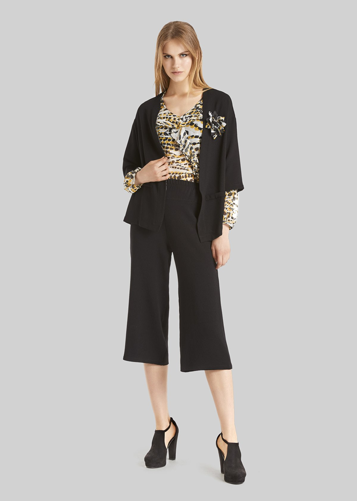 Crepe Carol shrug with flower-brooch detail