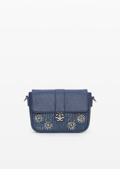 Faux leather and straw Betty clutch with flower closure