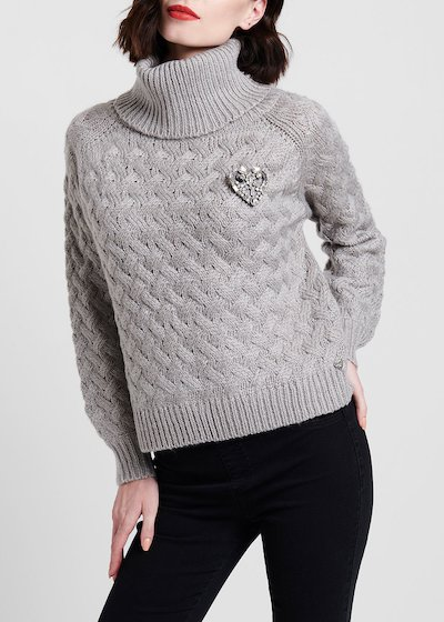 Oversize turtleneck sweater with criss cross processing