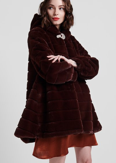 Faux - fur coat with puffball sleeve and jewel closure