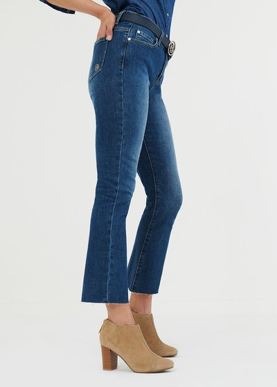 Flared denims with fringed hem