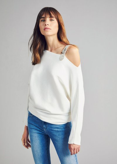 Asymmetric sweater with rhinestone buckle on the shoulder