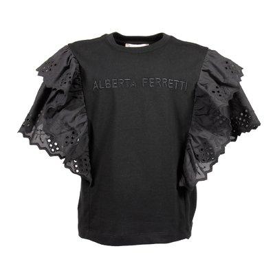 T-shirt nera in jersey di cotone con dettagli in pizzo di sangallo