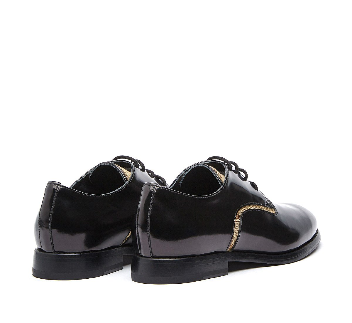 Four-hole lace-ups in calf leather