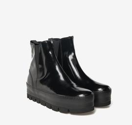 Sneaker alta in pelle lucida con elastico