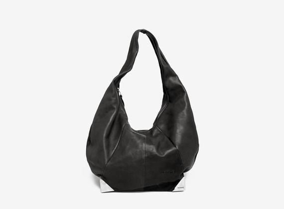 Leather bag with metal corners
