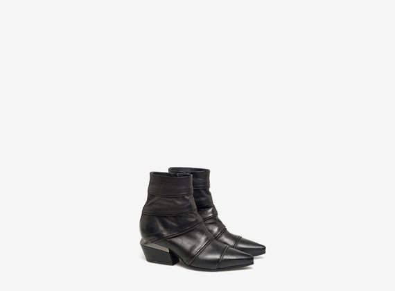 Multizip ankle boots with metal heel ornament