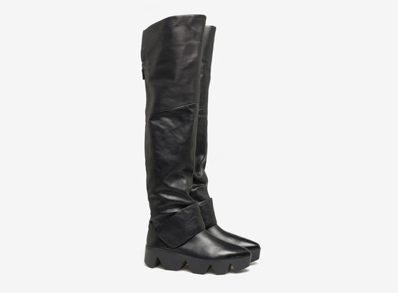 Thigh high boots with Velcro at the ankle