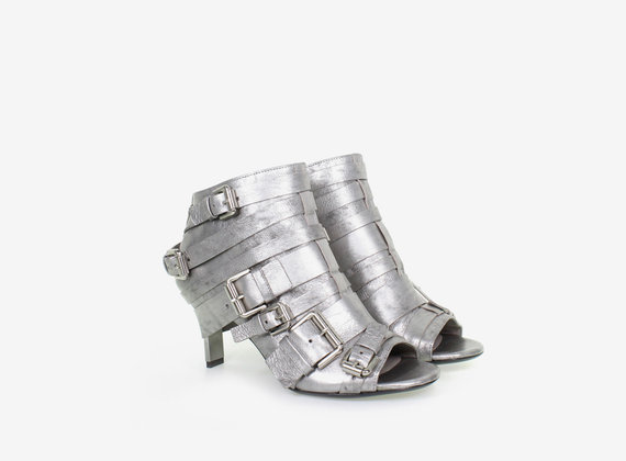 Multi-buckle, open toe ankle boot, crafted from laminate with steel heel