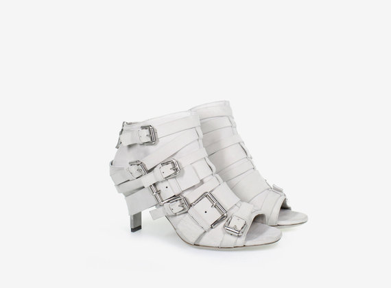 Multi-buckle open heel low ankle boot, crafted from nubuck with steel heel