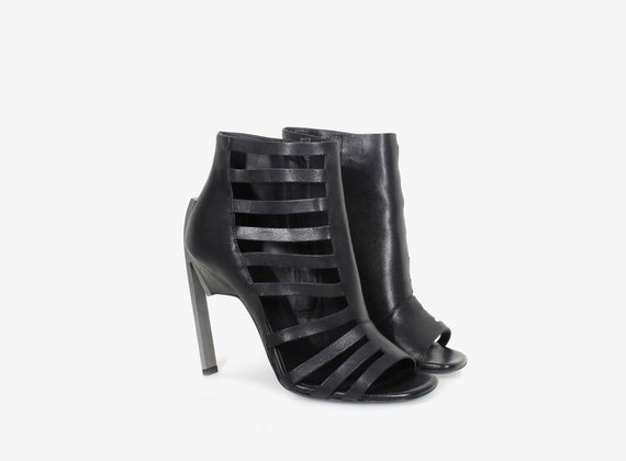 Open asymmetric ankle boot with steel heel