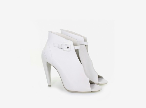 Open toe low ankle boot, with strap and shell-effect heel
