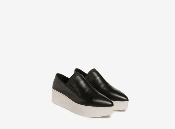White and black flatform slippers