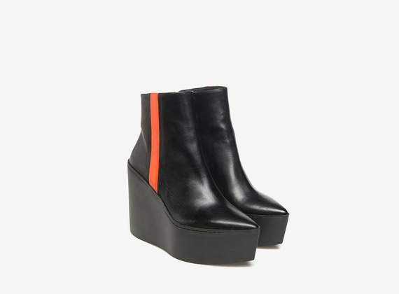 Orange rubber wedge ankle boots