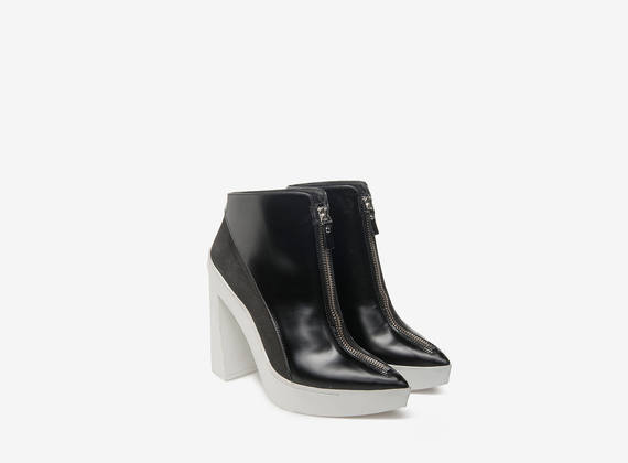 Zip ankle boots on white rubber soles