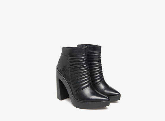 Rubber padded ankle boots