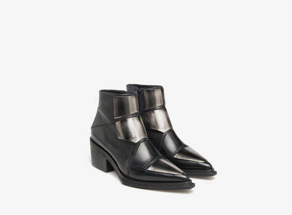 Ankle boots with metal inserts