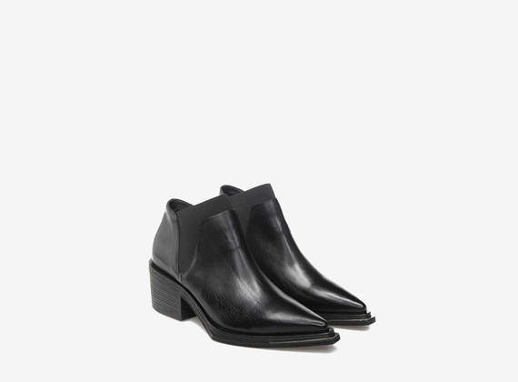 Zip ankle boots with elastic