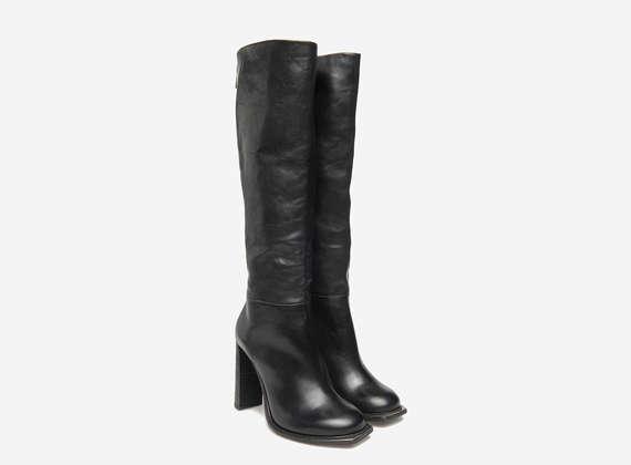 Boots avec détails métalliques sur la pointe