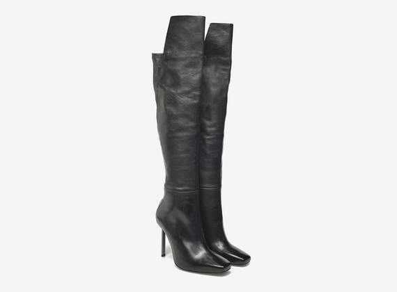 Over the knee boots with metal heels