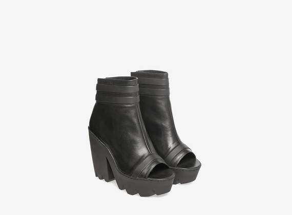 Black leather lug ankle boots