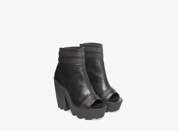 Black leather lug ankle boots