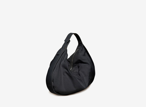 Black engraved crescent-shaped duffel bag