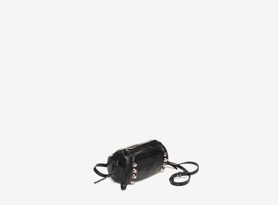 Black cylinder-shaped micro bag with studs