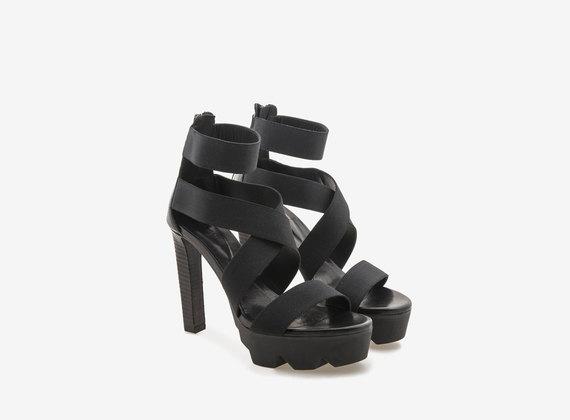 Sandalo tacco alto con carrarmato e fasce elastiche